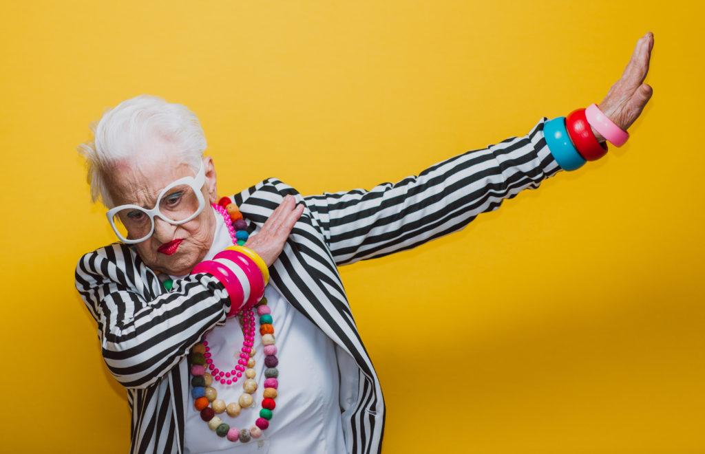 An elderly woman dabs.